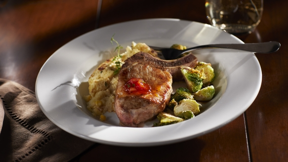 Recipe: Pork chops with sweet corn spoonbread and crispy Vietnamese Brussels sprouts